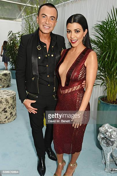Julien Macdonald and Kourtney Kardashian attend the Glamour Women Of The Year Awards in Berkeley Square Gardens on June 7 2016 in London United...