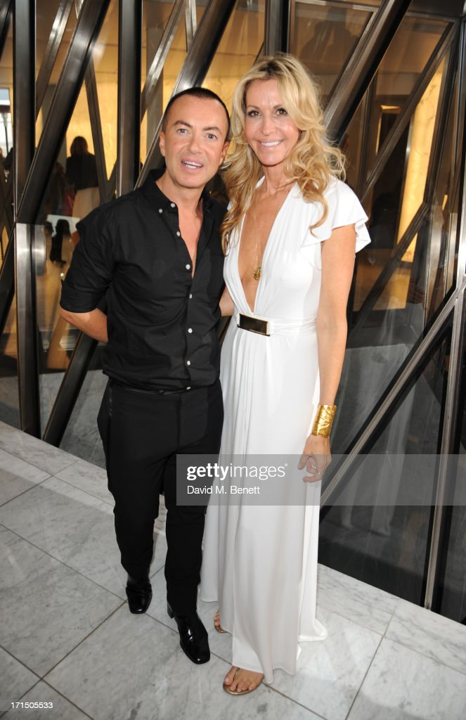 Julien Macdonald and Melissa Odabash attend the Odabash Macdonald Resort 2014 collection launch at ME Hotel on June 25, 2013 in London, England.