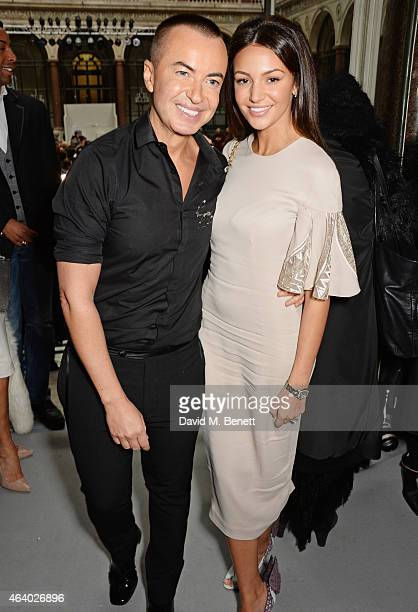 Julien Macdonald and Michelle Keegan pose backstage at the Julien Macdonald show during London Fashion Week Fall/Winter 2015/16 at British Foreign...