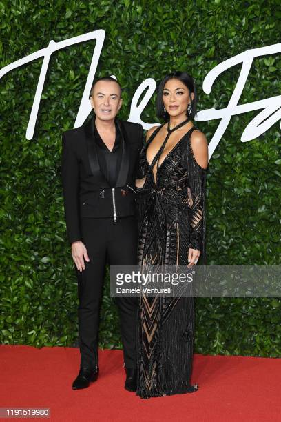 Julien Macdonald and Nicole Scherzinger arrive at The Fashion Awards 2019 held at Royal Albert Hall on December 02 2019 in London England