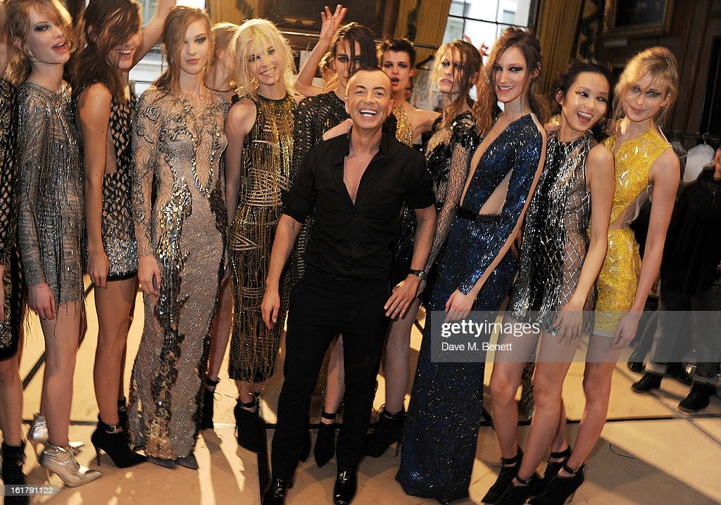 Julien Macdonald (C) celebrates with models backstage at the Julien Macdonald show during London Fashion Week Fall/Winter 2013/14 at Goldsmiths' Hall on February 16, 2013 in London, England.