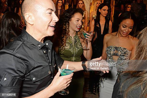 Julien Macdonald Ella Eyre and Sarah Jane Crawford pose backstage following the Julien Macdonald show during London Fashion Week Autumn/Winter...