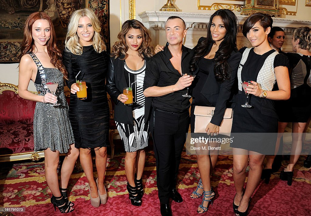 Julien Macdonald (C) poses with (L to R) Una Healy, Mollie King, Vanessa White, Rochelle Wiseman and Frankie Sandford backstage at the Julien Macdonald show during London Fashion Week Fall/Winter 2013/14 at Goldsmiths' Hall on February 16, 2013 in London, England.