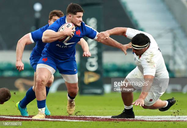 Julien Marchand of France holds off Mako Vunipola during the Guinness Six Nations match between England and France at Twickenham Stadium on March 13,...