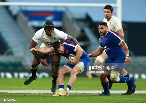 Julien Marchand of France is tackled by Maro Itoje during the Guinness Six Nations match between England and France at Twickenham Stadium on March...