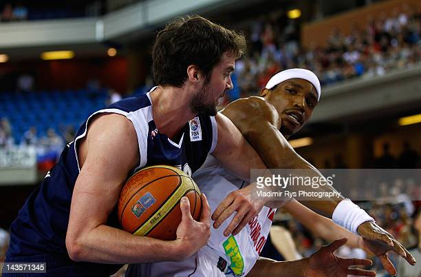Julien Mills of Szolnoki and Kyle Landry of Triumph battle for the ball during the FIBA Europe EuroChallenge Final Four third place game between...