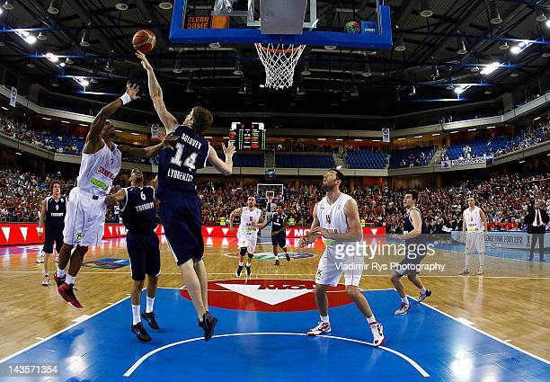 Julien Mills of Szolnoki shoots as Daniil Solovev of Triumph defends during the FIBA Europe EuroChallenge Final Four third place game between...