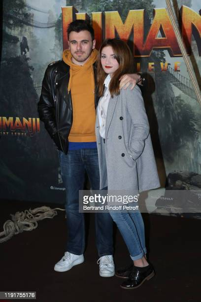 Julien Siphano and a guest attend the photocall of the Jumanji Next Level film at le Grand Rex on December 03 2019 in Paris France