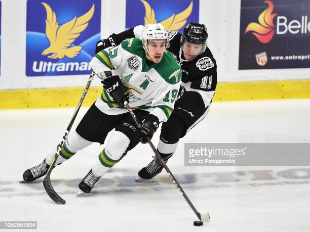 Julien Tessier of the ValdOr Foreurs skates the puck against Anthony Poulin of the BlainvilleBoisbriand Armada during the QMJHL game at Centre...