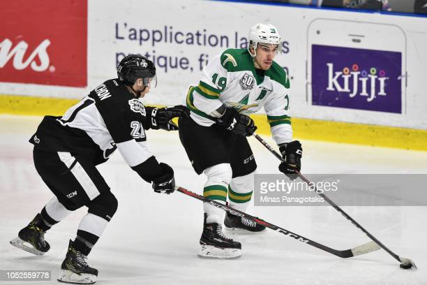 Julien Tessier of the ValdOr Foreurs skates the puck against Antoine Rochon of the BlainvilleBoisbriand Armada during the QMJHL game at Centre...