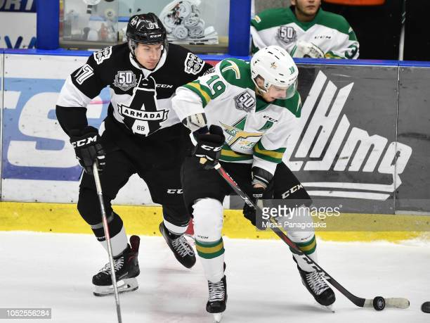 Julien Tessier of the ValdOr Foreurs skates the puck against Nathan Lavoie of the BlainvilleBoisbriand Armada during the QMJHL game at Centre...