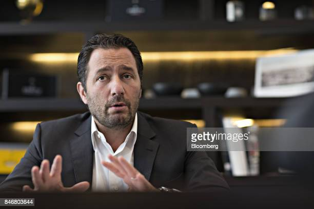 Julien Tornare chief executive officer of Zenith a watchmaking unit of LVMH Moet Hennessy Louis Vuitton SA gestures as he speaks during an interview...