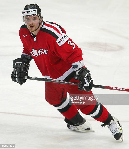 Julien Vauclair of Switzerland moves up the ice against Slovakia in the teams' quarter finals match at the International Ice Hockey Federation World...