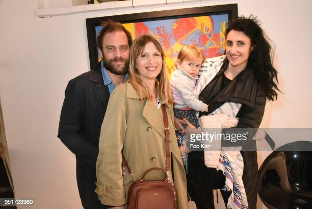 PR Julien Verry Aurelie Delaforge her daughter and Isabelle Teodorescu attend Mai 68 Painting Exhibition at Brugier Rigail Galerie on April 26 2018...