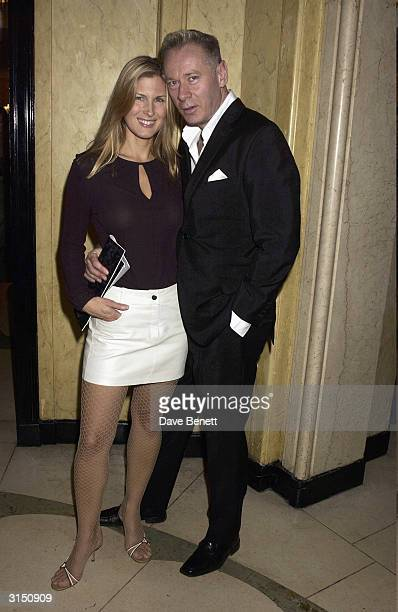 Julienne Davis and husband attend the Harpers and Moet Restaurant Awards at Claridges Hotel on November 4 2003 in London