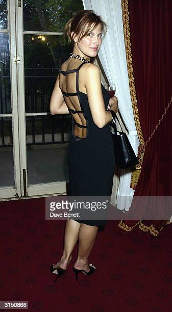 Julienne Davis attends the Queens Hats and Handbags Exhibition at Kensington Palace on May 28 2003 in London