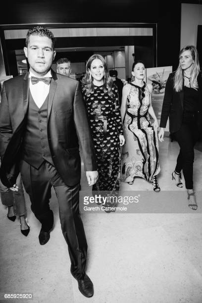 Julienne Moore departs the Martinez Hotel during the 70th annual Cannes Film Festival on May 19 2017 in Cannes France