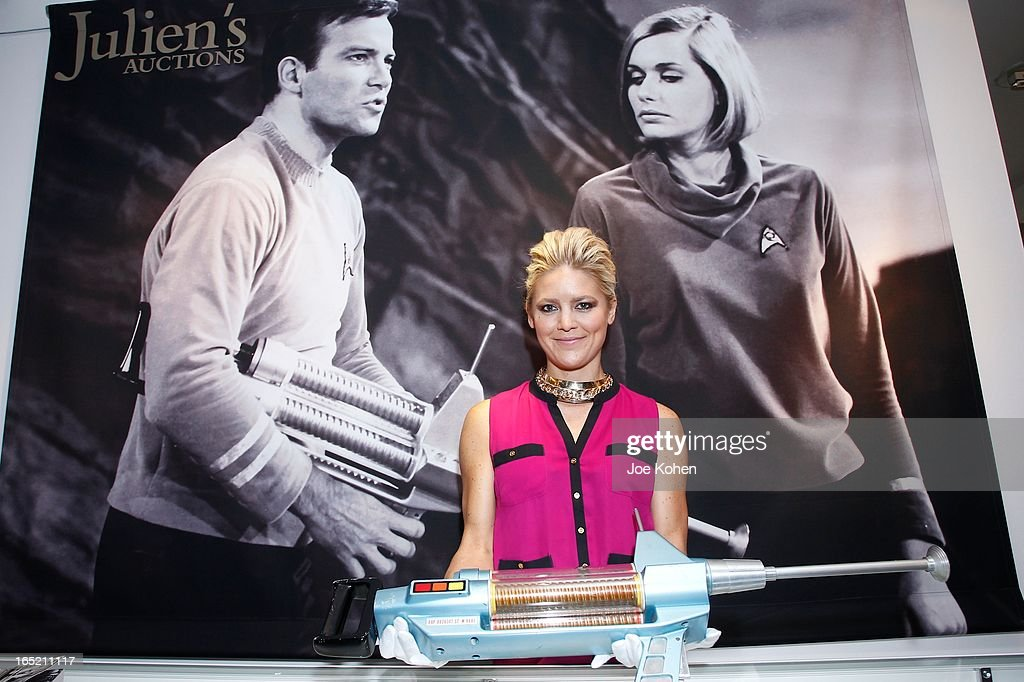Julien's Auctions Gallery manager Kimberly Noll poses for a photo with a Star Trek rifle at Julien's Auctions Gallery on April 1, 2013 in Beverly Hills, California.