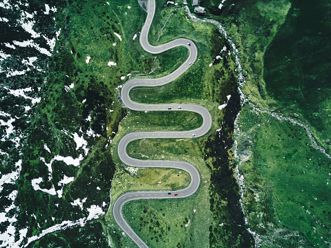 julier pass road in switzerland in autumn 874171760