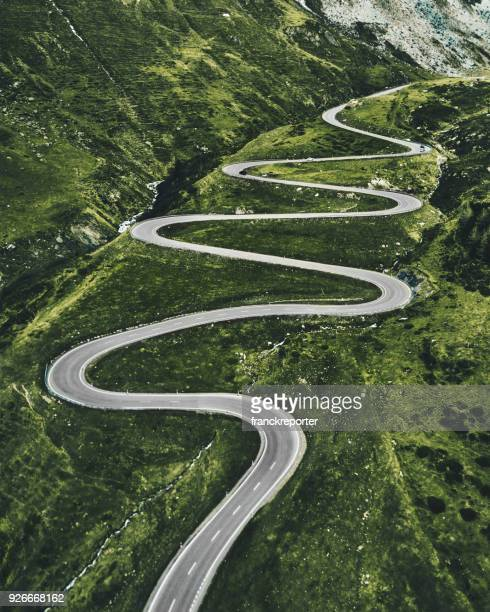 julier pass road in switzerland - road stock pictures, royalty-free photos & images