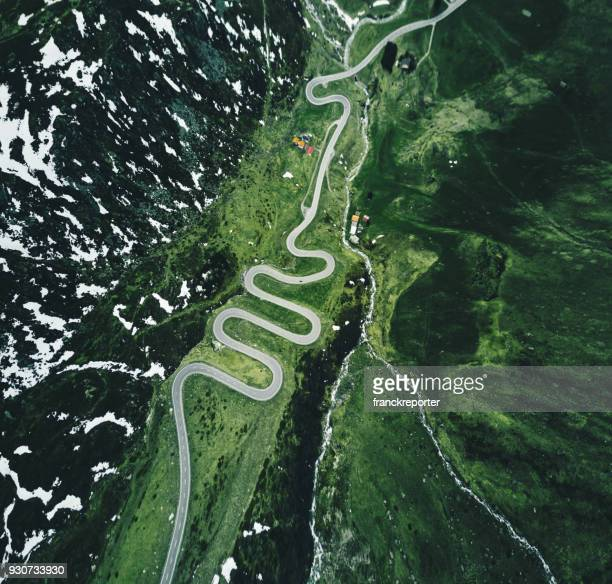 julier pass road in switzerland - hairpin curve stock photos and pictures