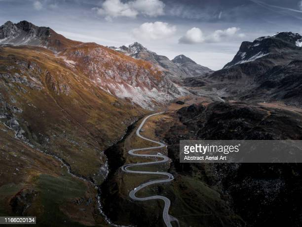julierpass with surrounding mountains, switzerland - mountain pass stock pictures, royalty-free photos & images