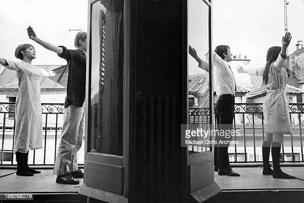 Juliet Berto Michel Semeniako JeanPierre Leaud and Anne Wiazemsky stretching out on patio in scene from the film 'La Chinoise' 1967