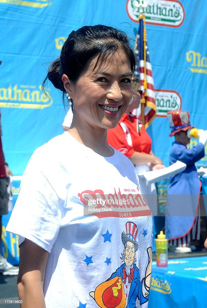 Juliet Lee finishes 2nd in the Woman's division of the 2013 Nathan's Famous Hot Dog Eating Contest at Coney Island on July 4, 2013 in New York City.
