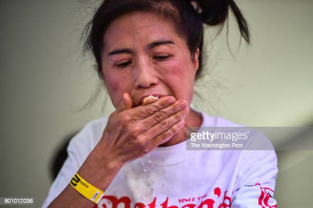Juliet Lee of Germantown MD competes on stage in the 2017 Hot Dog Eating Contest qualifier on Saturday June 24 in Washington DC The top male and...