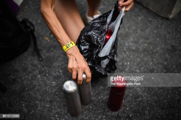 Juliet Lee of Germantown MD prepares her hot tea before going on the stage to compete in the 2017 Hot Dog Eating Contest qualifier on Saturday June...