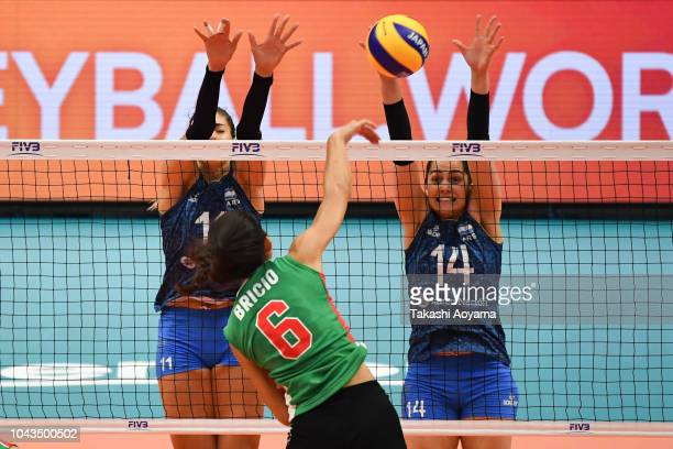 Julieta Constanza Lazcano and Josefina Fernandez of Argentina tries to block as Samantha Bricio of Mexico spikes the ball during the Group A match...