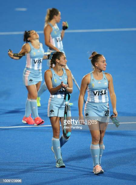 Julieta Jankunas of Argentina and team mates look dejected following defeat during the quarter final game between Australia and Argentina of the FIH...