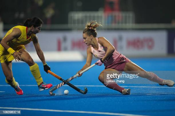 Julieta Jankunas of Argentina battles for the ball with Gu Bingfeng of China during the FIH Champions Trophy match between China and Argentina on...