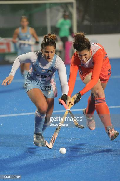 Julieta Jankunas of Argentina battles for the ball with Maxime Kerstholt of Netherlands during the FIH Champions Trophy match between Netherlands and...
