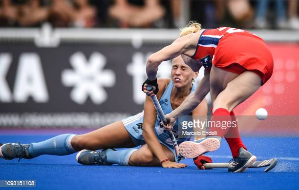 Julieta Jankunas of Argentina competes for the ball with Alyssa Manley of United States during the Women's FIH Field Hockey Pro League match between...