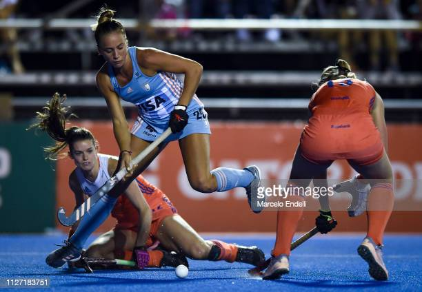Julieta Jankunas of Argentina competes for the ball with Caia van Maasakker of Netherlands during the women's FIH Field Hockey Pro League match...