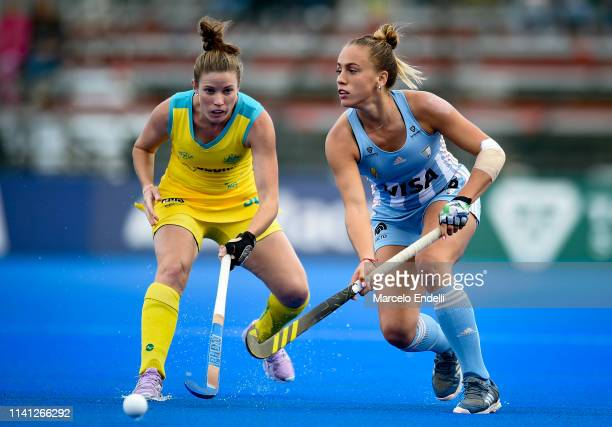Julieta Jankunas of Argentina competes for the ball with Kate Jenner of Australia during the Women's FIH Field Hockey Pro League match between...