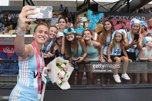 Julieta Jankunas of Argentina with her Player of the Match award takes selfies for the fans during the Pool C game between Argentina and Spain of the...