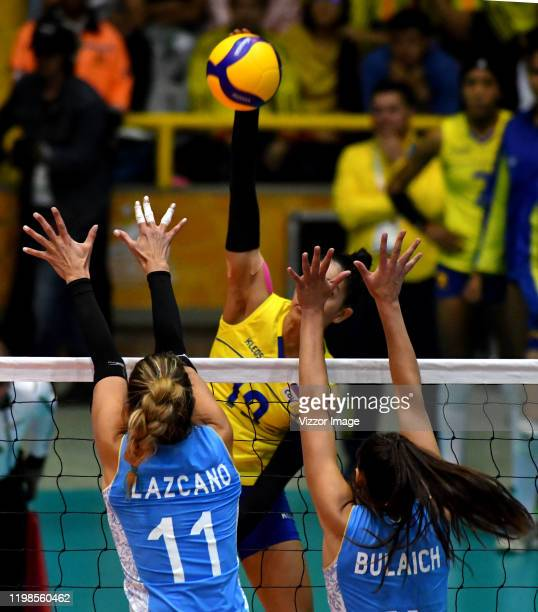 Julieta Lazcano and Daniela Bulaich of Argentina try to block the ball shot by Amanda Coneo of Colombia during a match between Argentina and Colombia...
