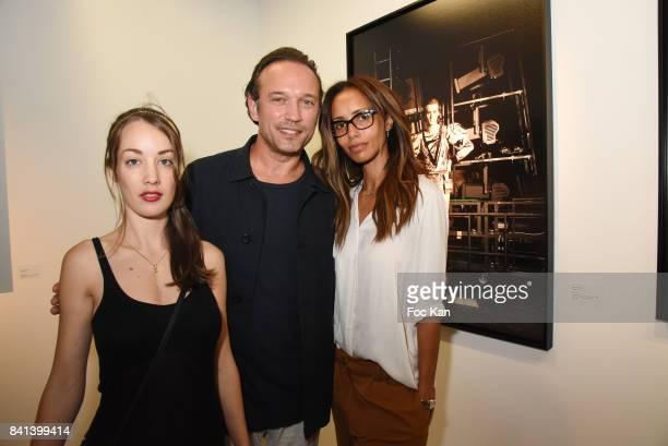 Juliette Besson Vincent Perez and Sonia Rolland attend 'Bolchoi' Vincent Perez Photo Exhibition Preview at Royal Monceau on August 31 2017 in Paris...
