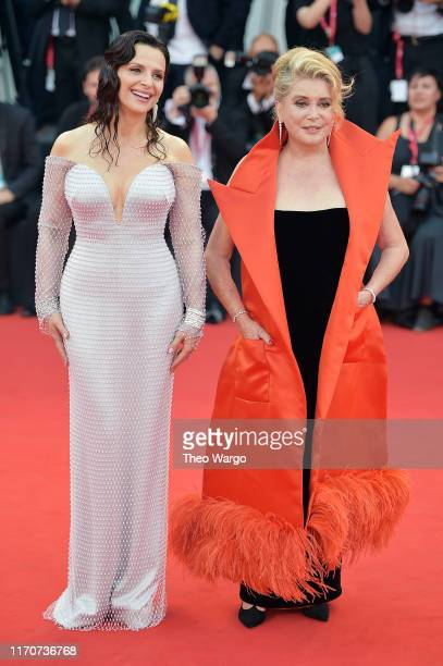 Juliette Binoche and Catherine Deneuve walk the red carpet ahead of the Opening Ceremony and the La Vérité screening during the 76th Venice Film...