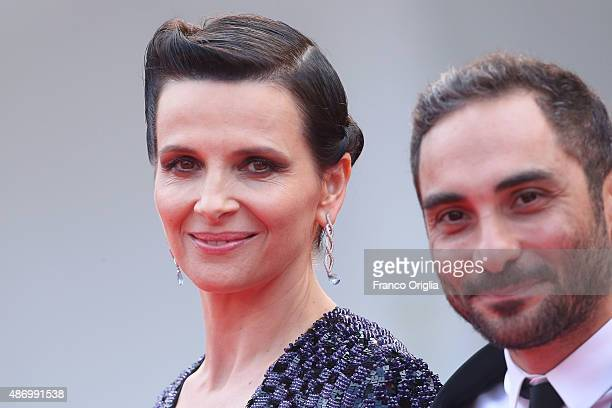 Juliette Binoche and director Piero Messina attend a premiere for 'The Wait' during the 72nd Venice Film Festival at on September 5 2015 in Venice...