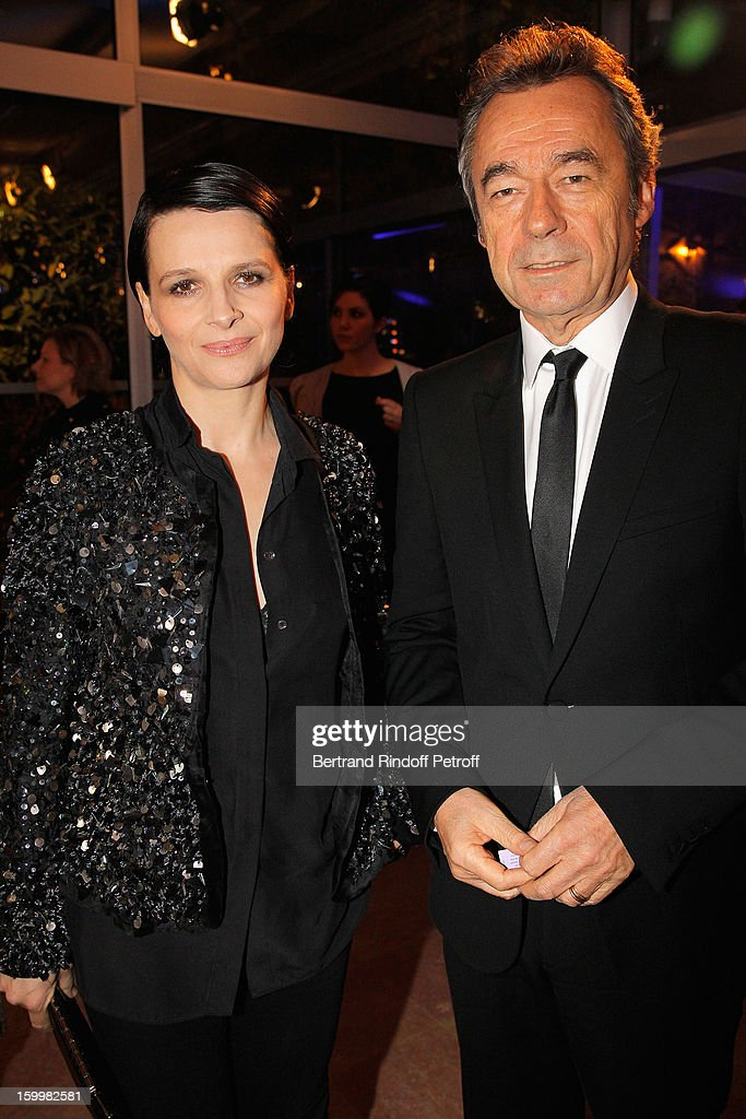 Juliette Binoche (L) and Michel Denisot pose as they arrive to attend the Sidaction Gala Dinner 2013 at Pavillon d'Armenonville on January 24, 2013 in Paris, France.