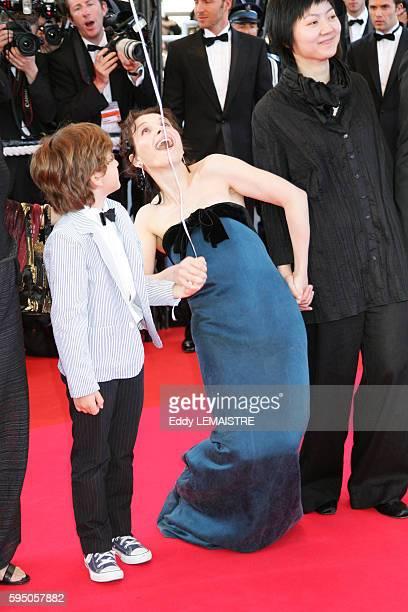 Juliette Binoche and Simon Iteanu arrive at the premiere of 'Zodiac' during the 60th Cannes Film Festival