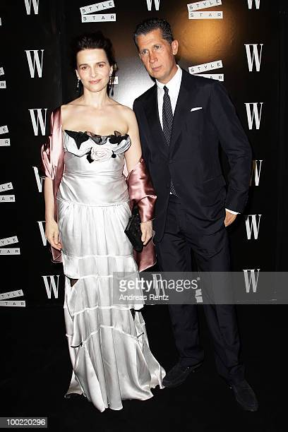 Juliette Binoche and Stefano Tonchi attend the Style Star Night Party at Carlton Beach during the 63rd Annual Cannes Film Festival on May 21 2010 in...