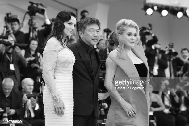 "Juliette Binoche, Hirokazu Koreeda and Catherine Deneuve walk the red carpet ahead of the Opening Ceremony and the ""La Vérité"" screening during the..."