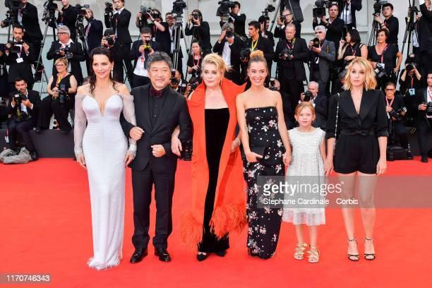 Juliette Binoche, Hirokazu Koreeda, Catherine Deneuve, Manon Clavel, Clementine Grenier and Ludivine Sagnier walk the red carpet ahead of the opening...
