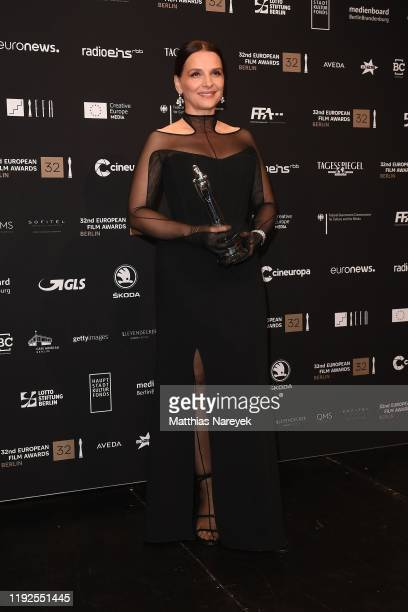 Juliette Binoche poses with her award European Achievement in World at the 32nd European Film Awards at Haus Der Berliner Festspiele on December 07,...