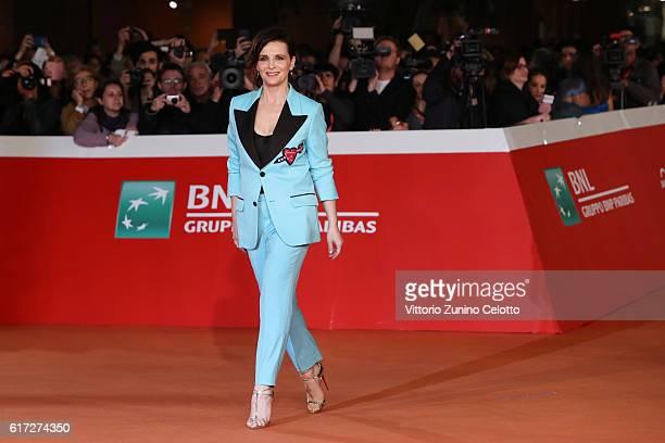 Juliette Binoche walks a red carpet for 'The English Patient - Il Paziente Inglese' during the 11th Rome Film Festival at Auditorium Parco Della...