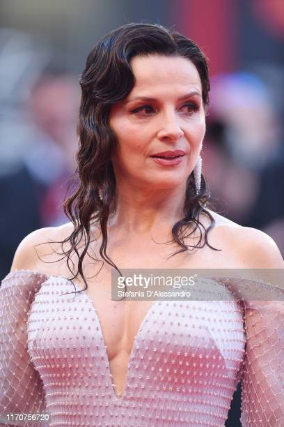 Juliette Binoche walks the red carpet ahead of the Opening Ceremony and the La Vérité screening during the 76th Venice Film Festival at Sala Grande...